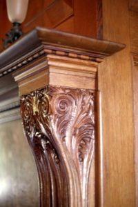 A mantel detail from a Colonial Revival style interior.