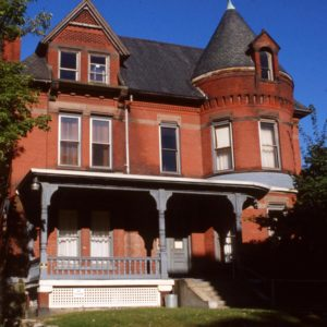 Queen Anne home with fine detail in the brickwork including the massive turret.