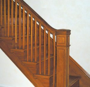 Interior detail of a Gumwood balustrade and newel post in an American Foursquare house.