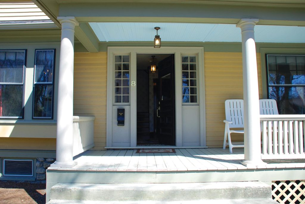 Porch detail in a classic American Foursquare home located in Worcester, Massachusetts.