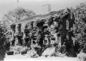The Carr Homestead blanketed with climbing vines.