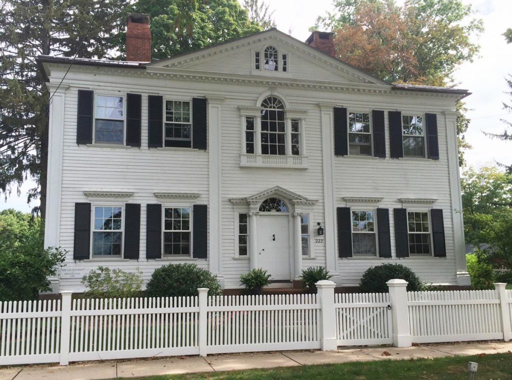 Fancy historic Federal home with two Palladian windows and a dentil molded dormer.