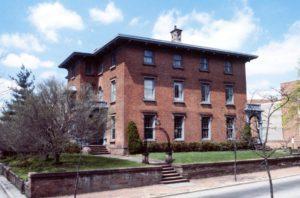 A three story brick Italianate style home