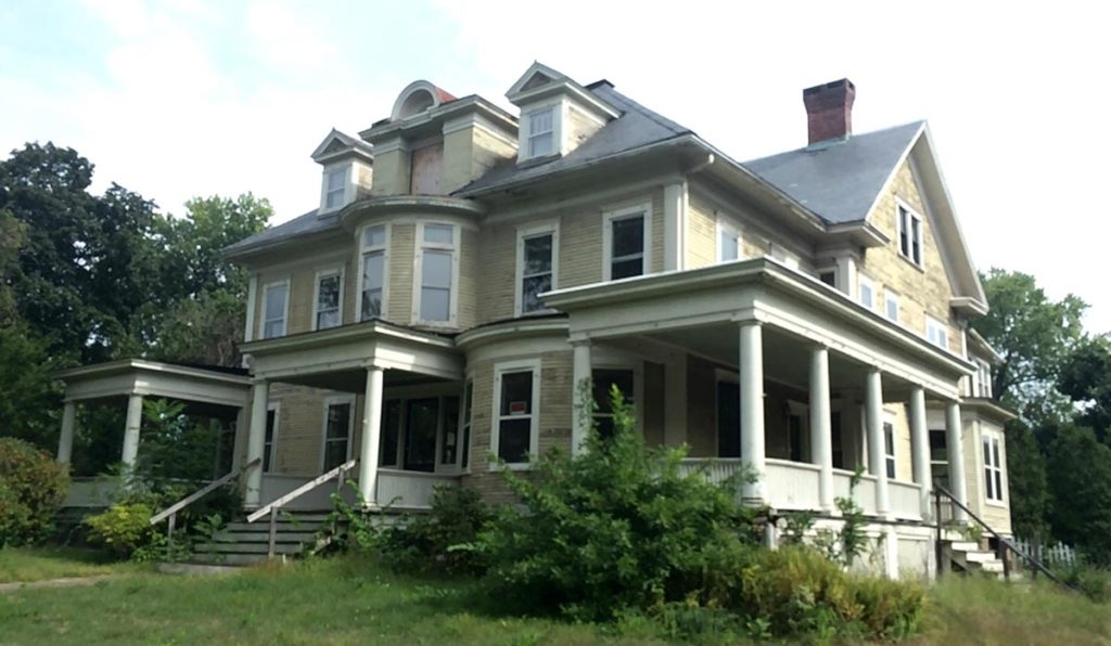 This circa 1900 Four-Square is framed by three sprawling, columned porches, and has bow windows on the first and second floor, along with a Palladian inspired dormer in the center of the roof.