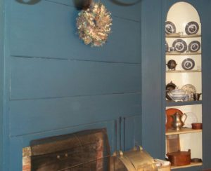 Prussian Blue fireplace wall and corner cupboard.