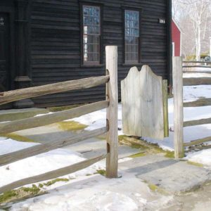 Split rail fence with a solid board gate