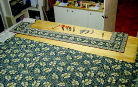 Stitching together the carpet rolls.